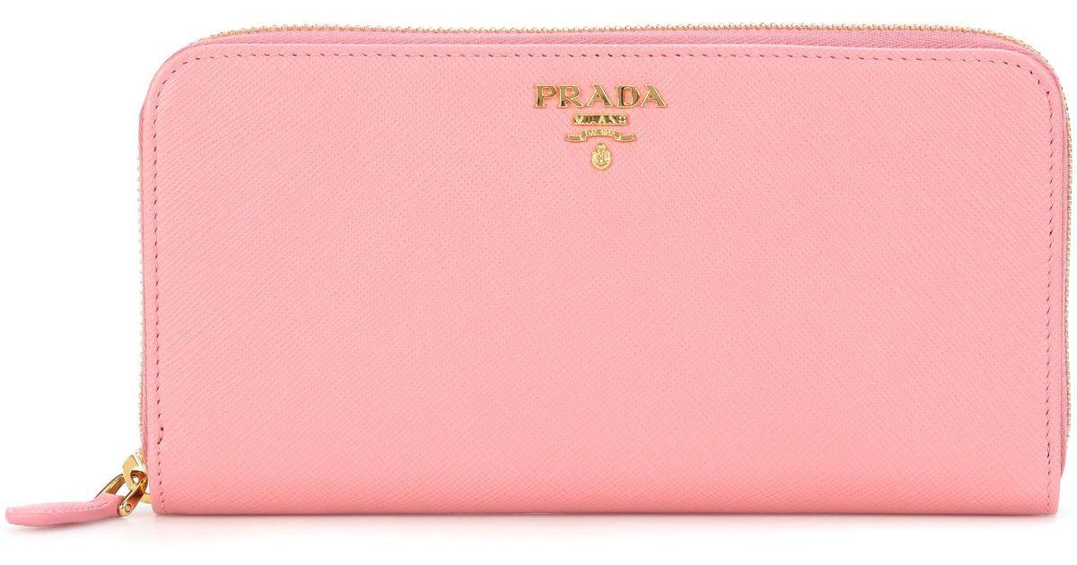 b3eb1d9f7b0443 Lyst - Prada Saffiano Leather Zip-around Wallet in Pink