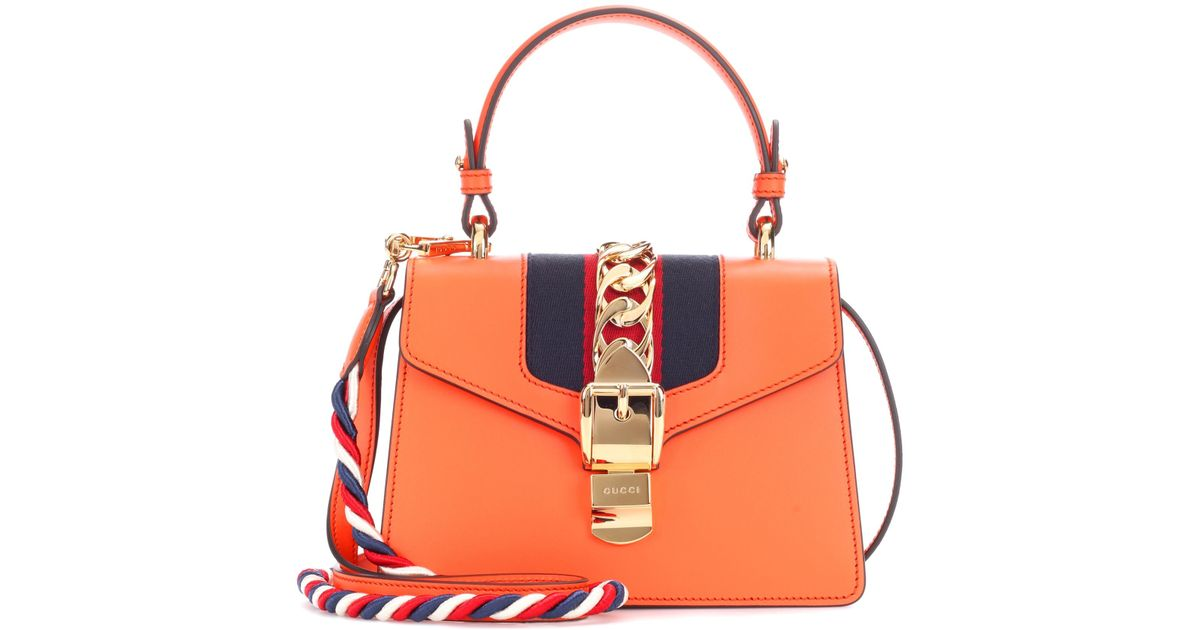 1f1b4682158b Gucci Sylvie Mini Leather Crossbody Bag in Orange - Lyst