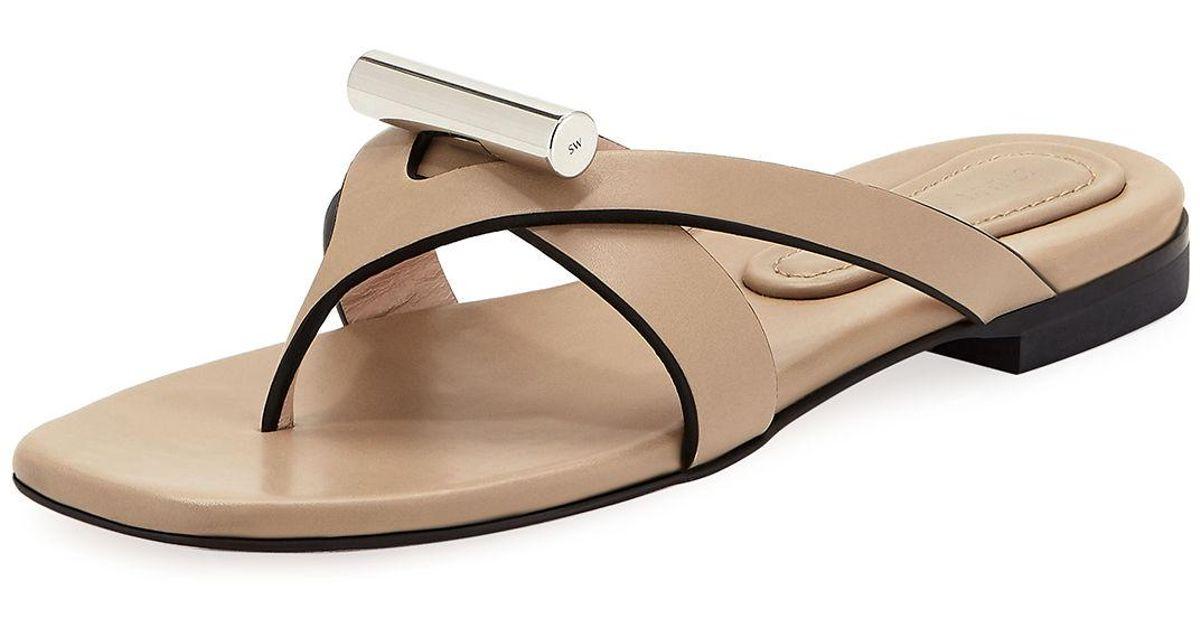 b7e78ebe1ea Lyst - Stuart Weitzman Arro Flat Thong Slide Sandals in Natural