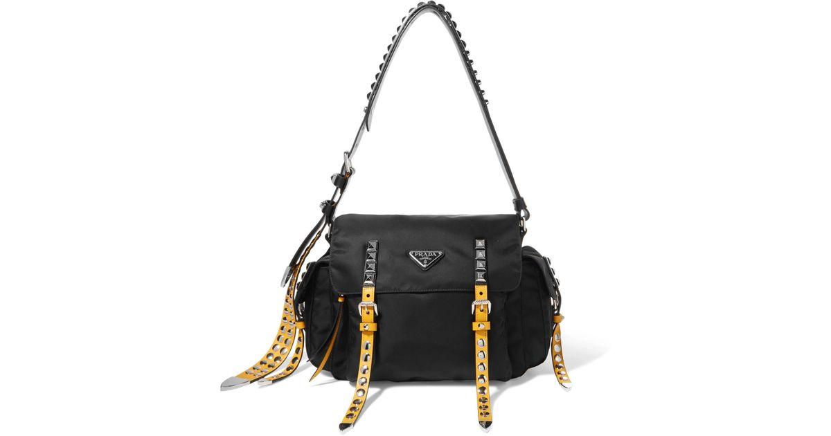 b547cd5a27fb Prada New Vela Studded Leather-trimmed Shell Shoulder Bag in Black - Lyst