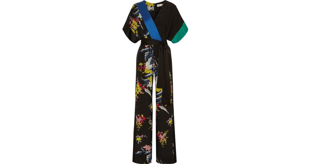 0dc0a97a3430 Diane von Furstenberg Wrap-effect Belted Floral-print Silk Crepe De Chine  Jumpsuit in Black - Lyst