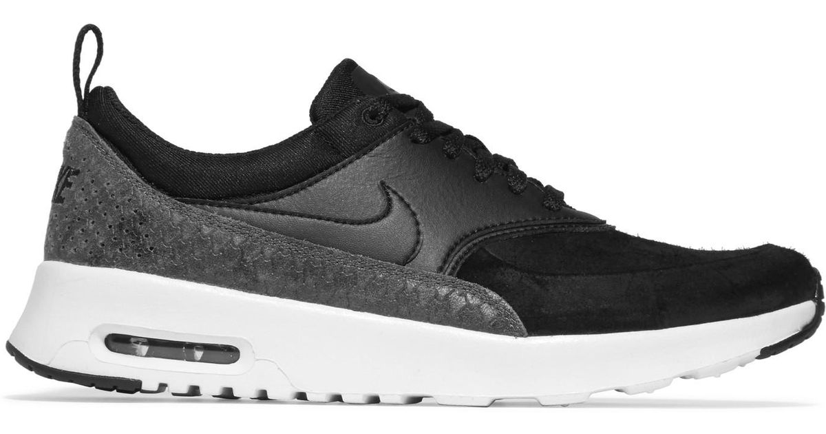 newest 38ec8 e5add ... best price nike air max thea suede smooth and snake effect leather  sneakers in black lyst