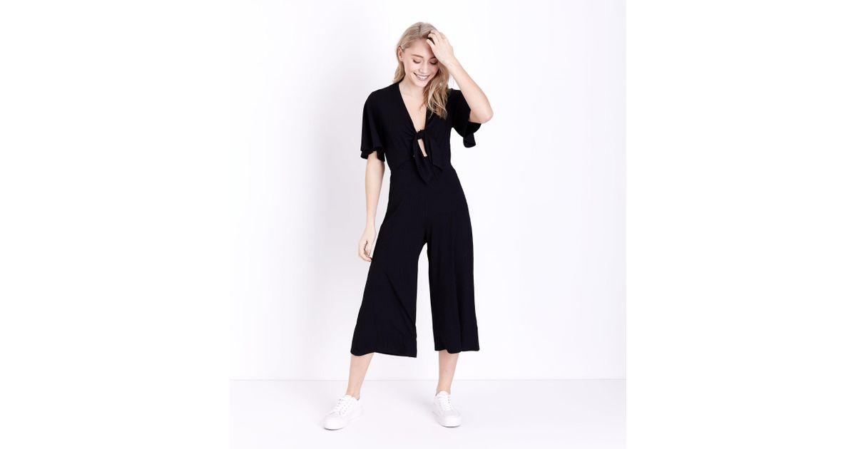 f109a52ffd66 New Look Petite Black Tie Front Ribbed Culotte Jumpsuit in Black - Lyst