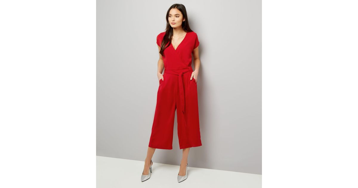 268e1e015f2 New Look Red Plissé Wrap Front Culotte Jumpsuit in Red - Lyst