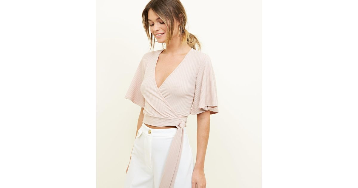 5c0df773f5b New Look Pale Pink Flutter Sleeve Wrap Crop Top in Pink - Lyst