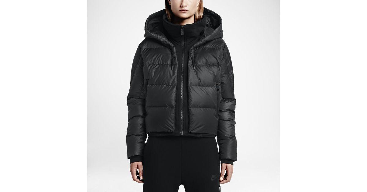 f730841499a1 Lyst - Nike Uptown 550 Down Cocoon Women s Jacket in Black
