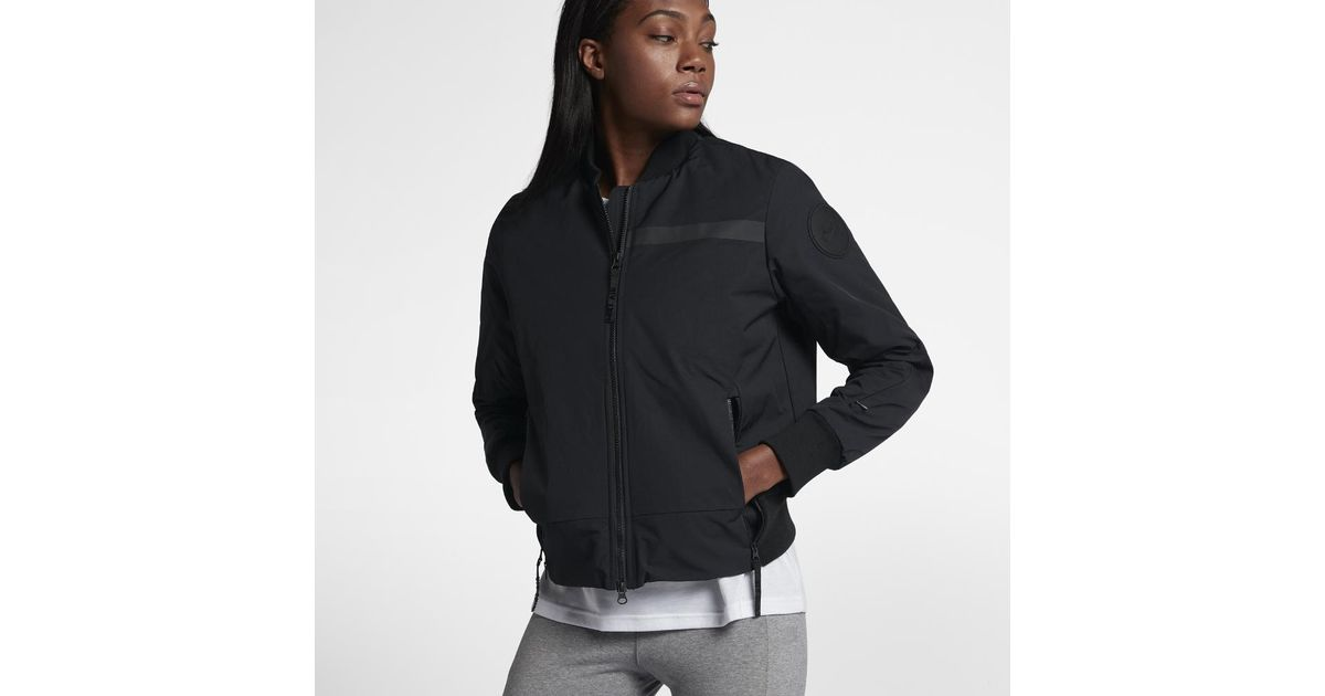 6ae773996bc5 Lyst - Nike Air Bomber Women s Woven Jacket in Black