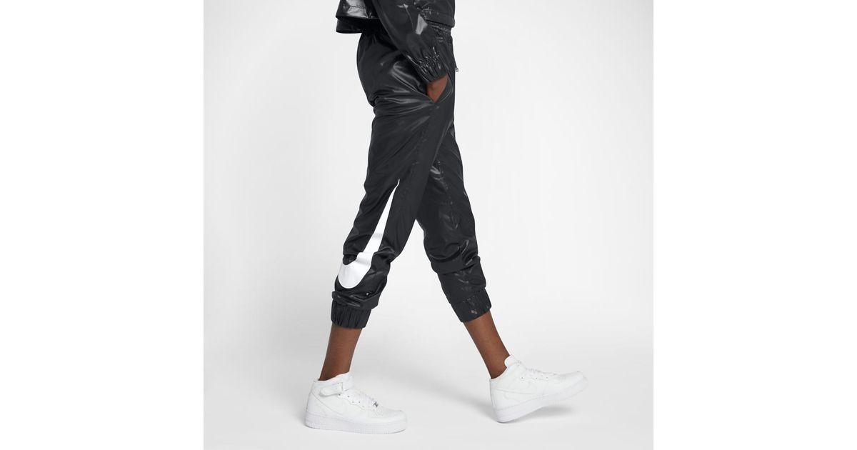 38c196e5e Lyst - Nike Sportswear Swoosh Women s Woven Pants in Black