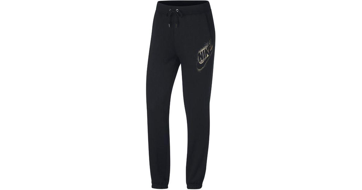 344e3c2a4e53 Lyst - Nike Sportswear Rally Women s Loose Fit Pants in Black