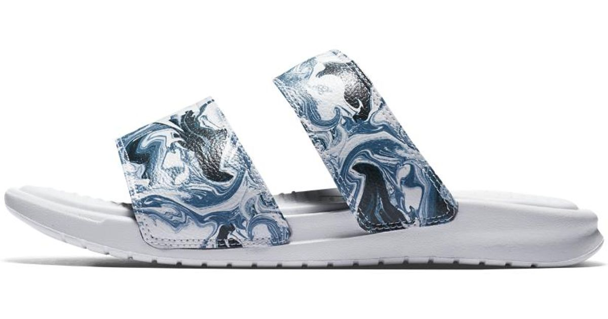 3f451d51762 Lyst - Nike Benassi Duo Ultra Marble Women s Slide Sandal in Blue