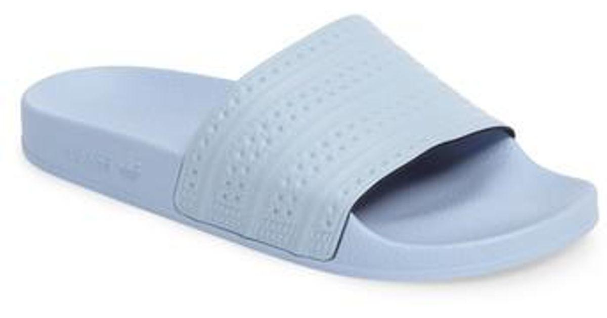 b2504f0684f3 Lyst - adidas Adilette Slide Sandal in Blue