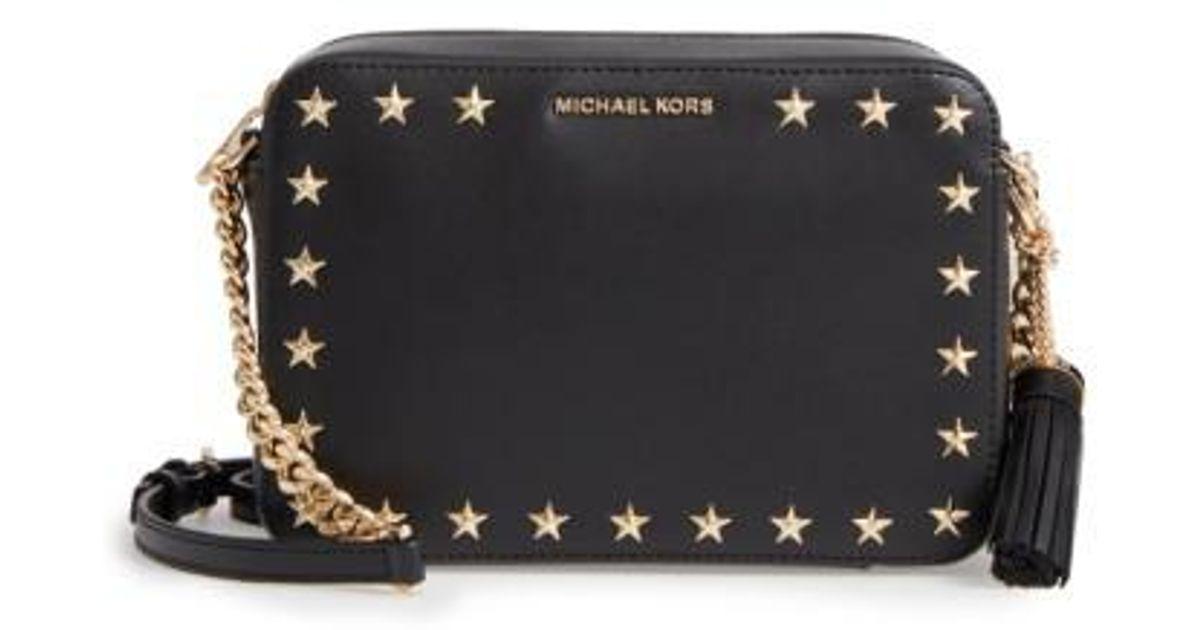 2d068f4f569a Lyst - MICHAEL Michael Kors Medium Ginny Star Studded Leather Crossbody  Camera Bag in Black