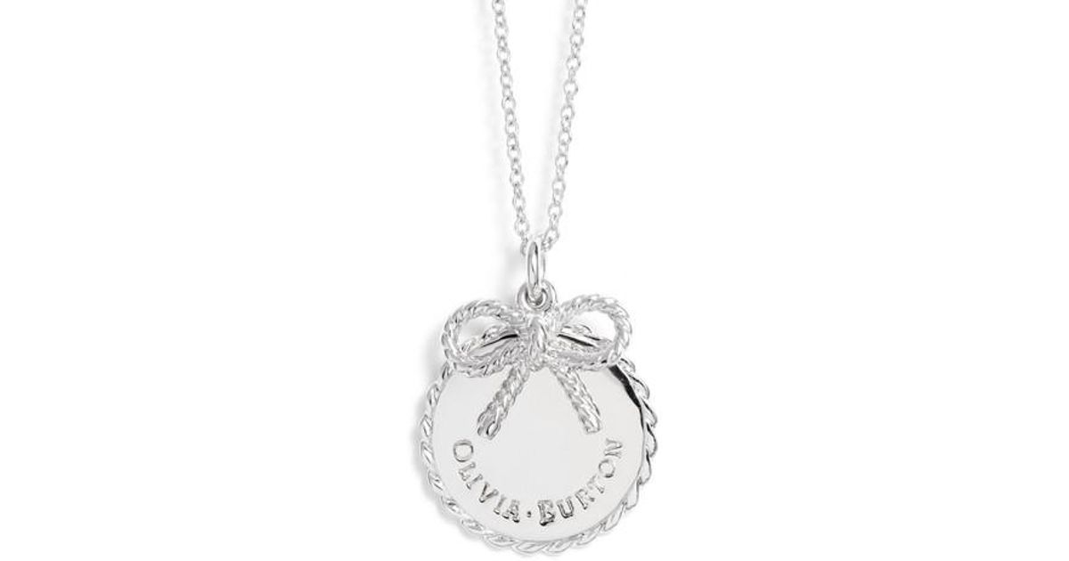 Lyst olivia burton coin bow pendant necklace in metallic aloadofball Images