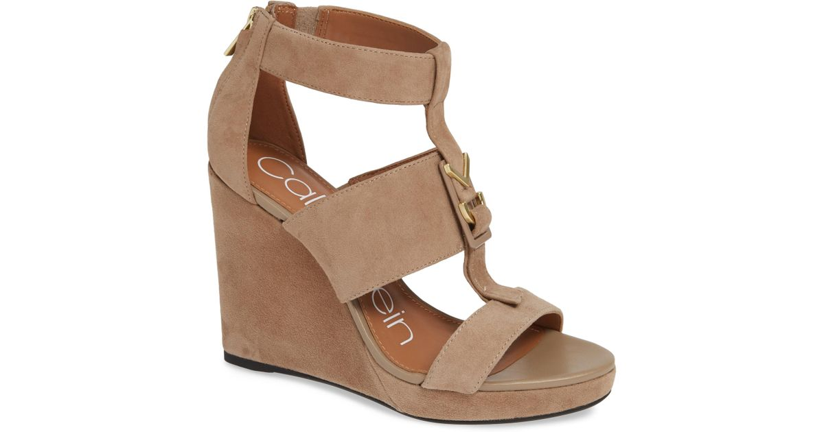 ba1111087115 Lyst - Calvin Klein Racquel Wedge Sandals in Brown