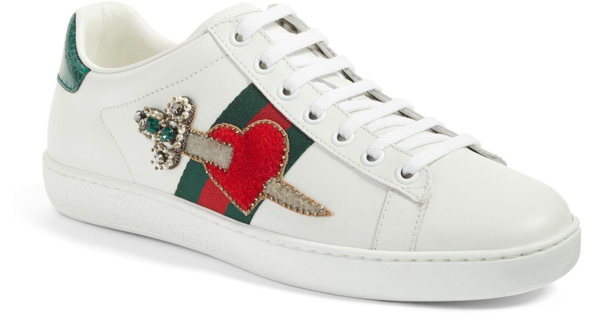 8c6d19d362d Lyst - Gucci New Ace Pierced Heart Sneaker
