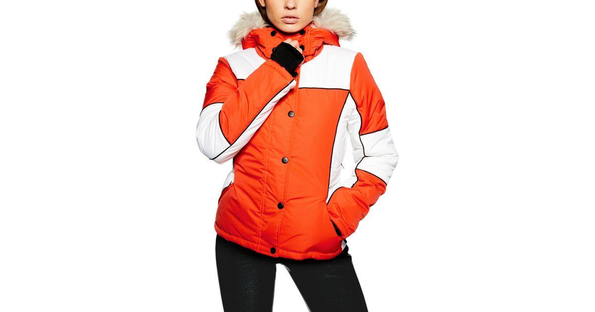 52be17ef230a TOPSHOP Sno Faux Fur Trim Puffer Jacket in Orange - Lyst