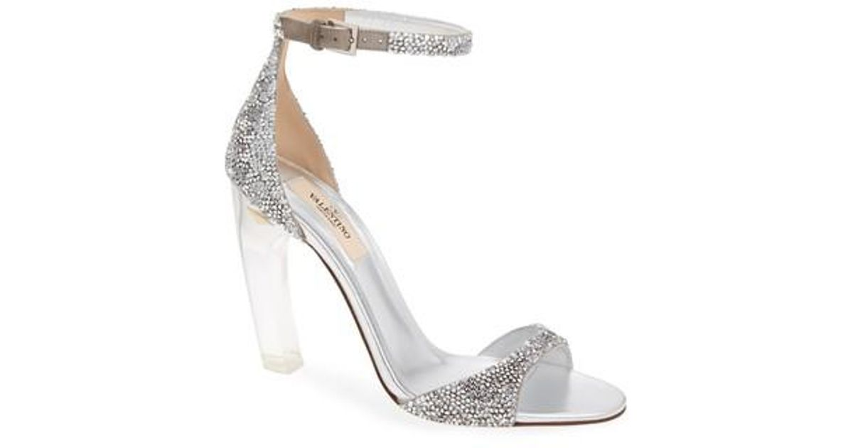 4ccd12dc1cb Lyst - Valentino Garavani Crystal Embellished Clear Heel Sandal in Metallic