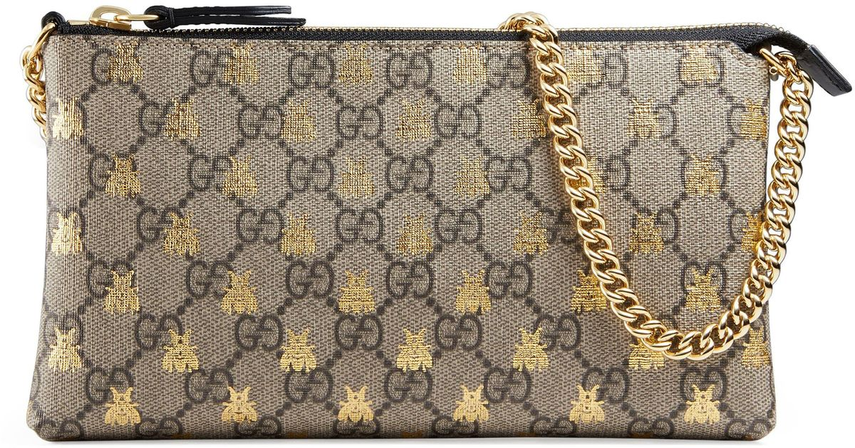 4e017e5d201c Gucci Linea Bee Gg Supreme Wrist Wallet in Natural - Lyst