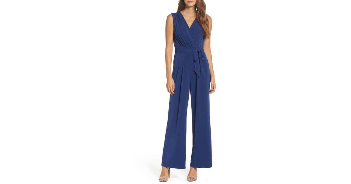 Lyst Vince Camuto Faux Wrap Jersey Jumpsuit In Blue