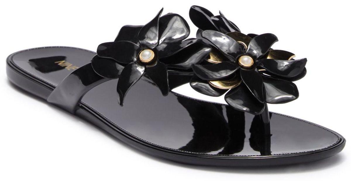 f308a107107c Lyst - Nine West Mapilo Flower Embellished Jelly Flip Flop (women) in Black