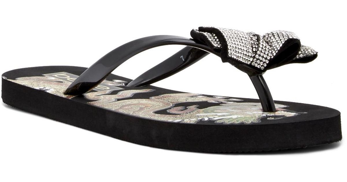 502c5063515ce Lyst - Bebe Addie Crystal Bow Flip Flop in Black