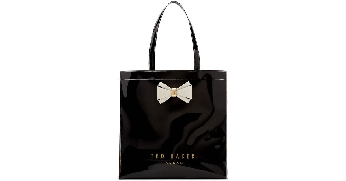 79ff4c54b0 Lyst - Ted Baker Alacon Bow Large Icon Bag in Black
