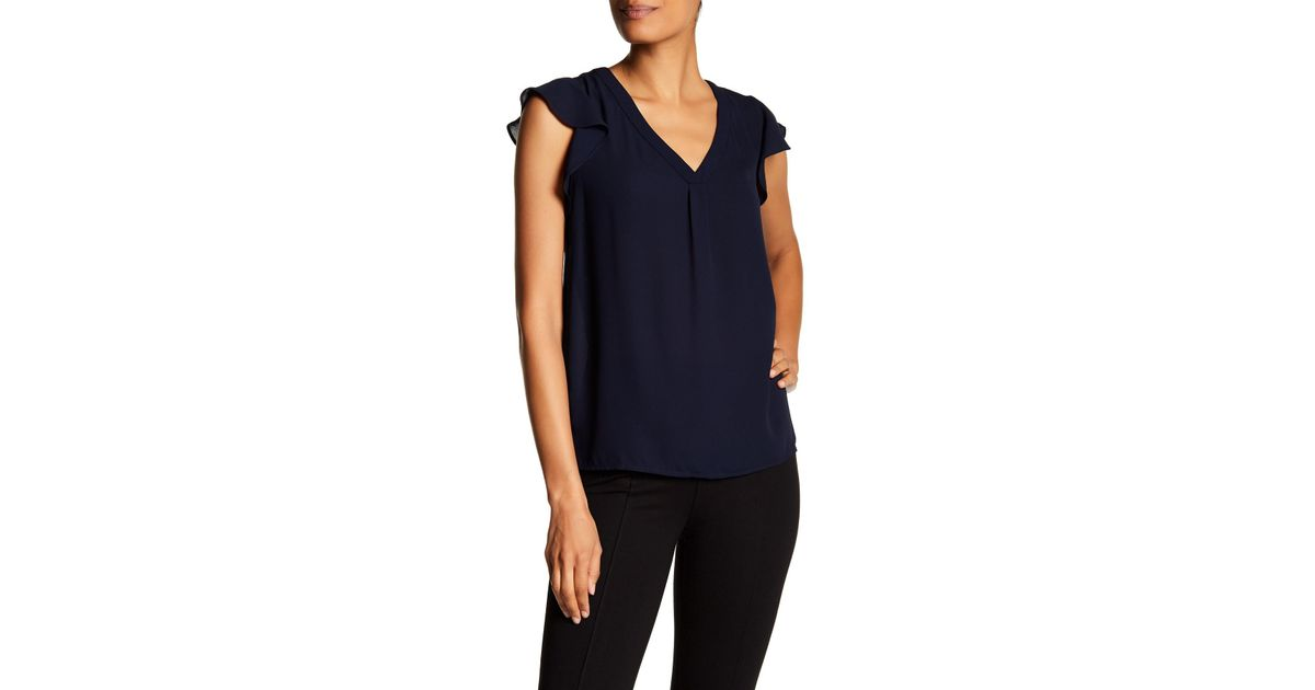 1d9fa6226f71eb Lyst - Philosophy Apparel Solid Ruffle Sleeve Blouse in Blue