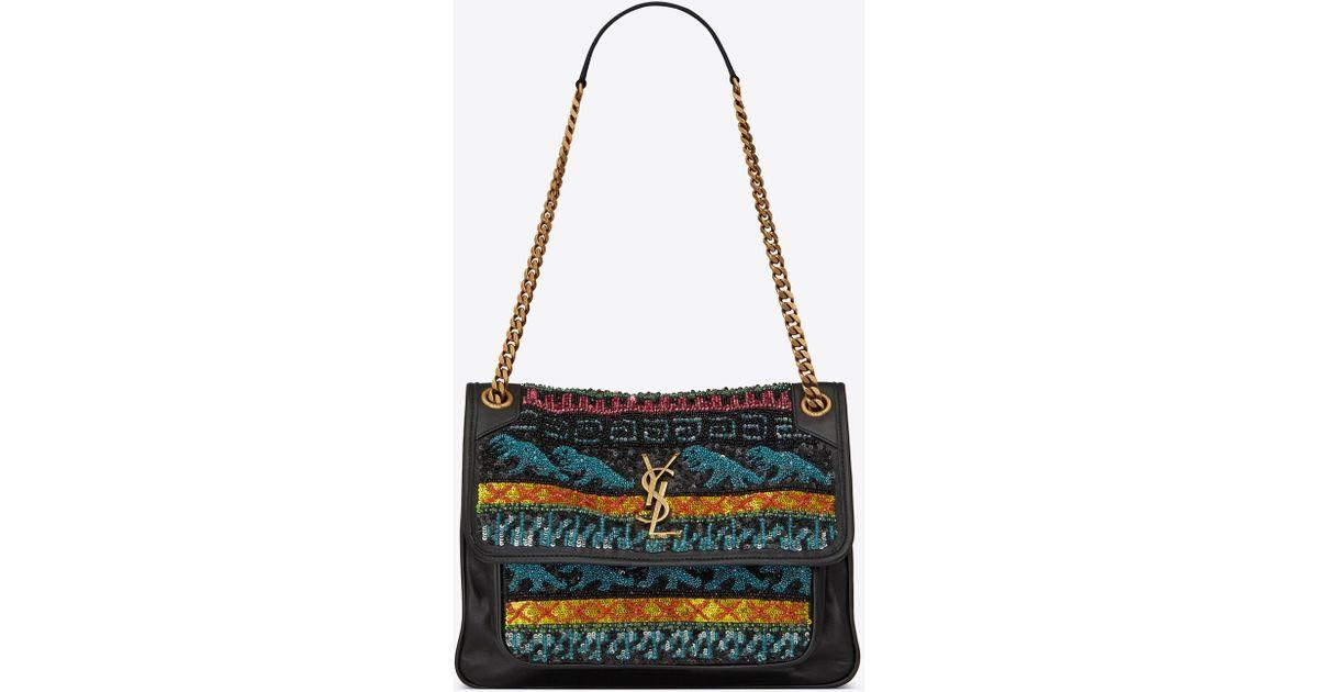 9063a075d53 Lyst - Saint Laurent Medium Niki Bag Decorated With Dinosaur Embroideries  in Black