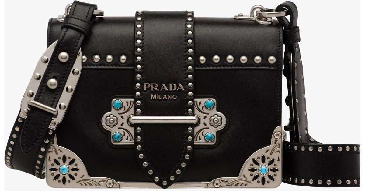 cc728b135df0 Lyst - Prada Cahier Studded Calf Leather Bag in Black