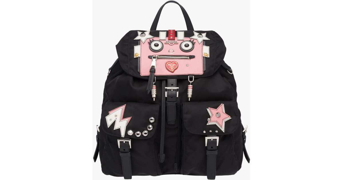 7d8dbee792e4 ... shopping lyst prada leather and fabric backpack with robot in black  47c5e b98b0