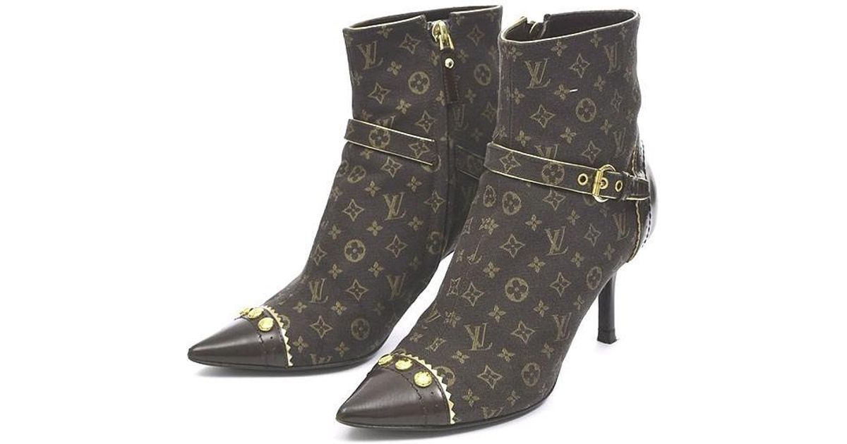 66d092ddac4 Lyst - Louis Vuitton Monogram Mini Heel Short Boots Women s   34 1 2 in  Brown