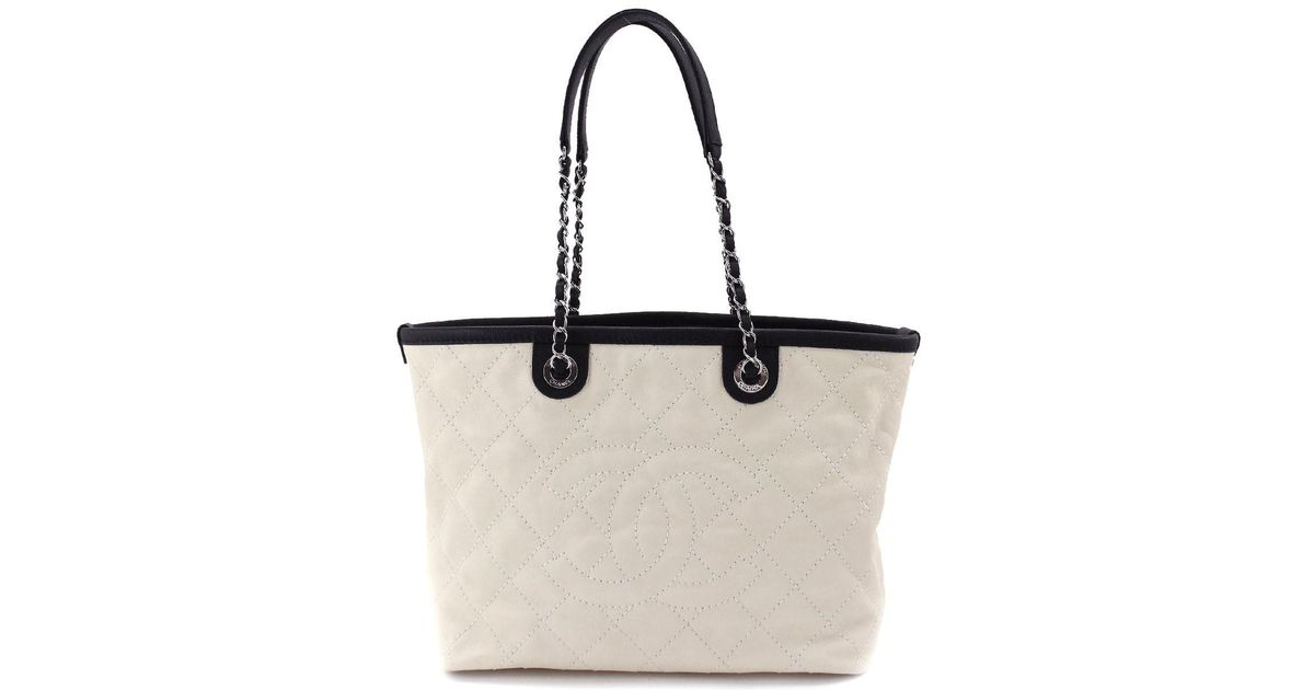 Lyst - Chanel Caviar Skin Leather Cc Chain Shoulder Tote Bag Cream Black in  Black ef76a06423d21