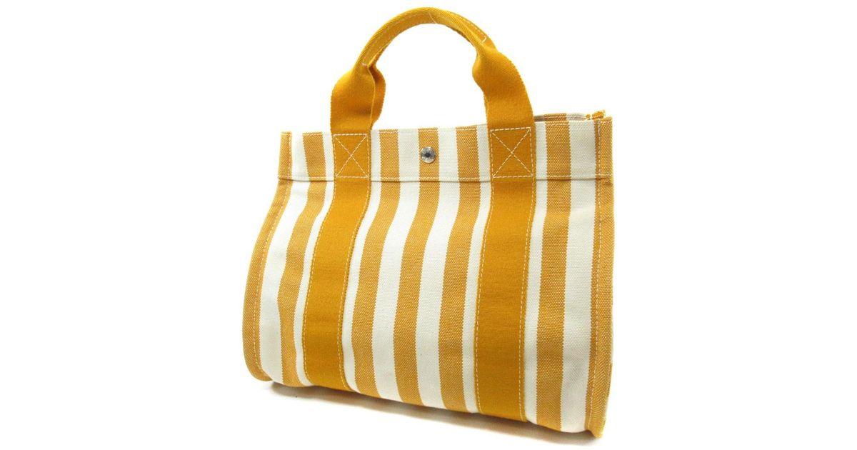9d3bede000a5 ... canada lyst hermès canvas tote bag cannes in orange 38d58 c2591 ...