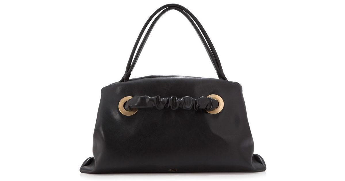 9a626219e4 Lyst - Céline Céline Small Purse With Eyelet in Black