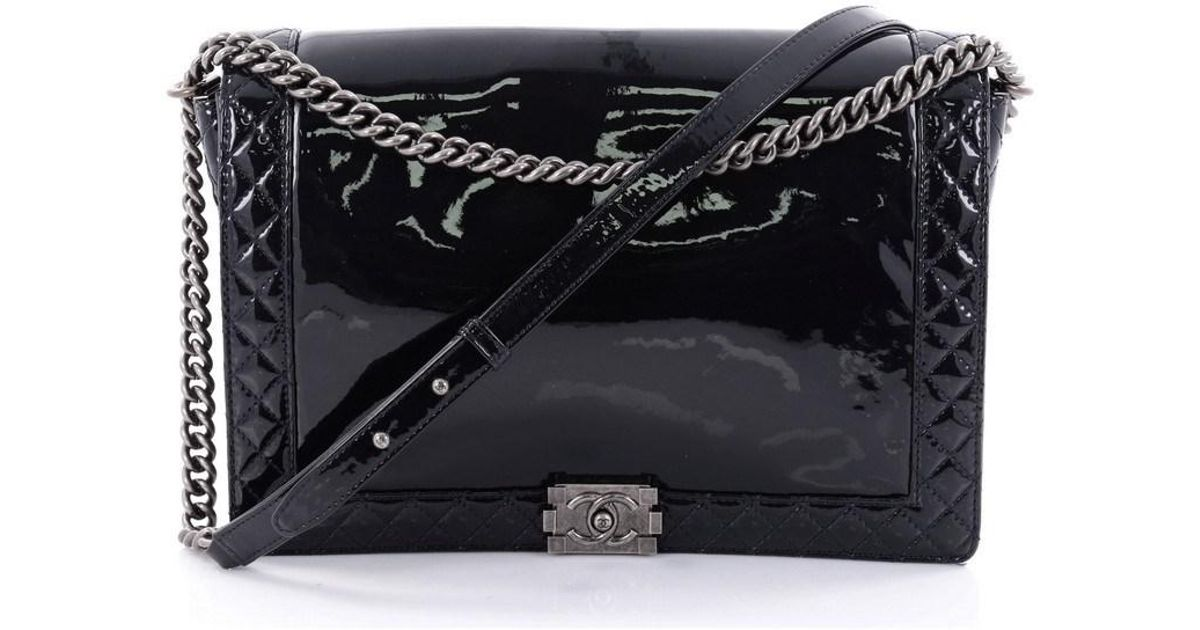 f8e3ad472edb Chanel Reverso Boy Flap Bag Patent Large in Blue - Lyst