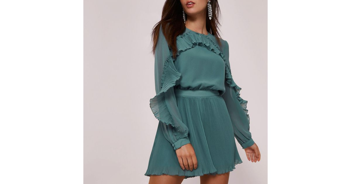 7683867145 River Island Green Long Sleeve Pleated Frill Playsuit in Green - Lyst