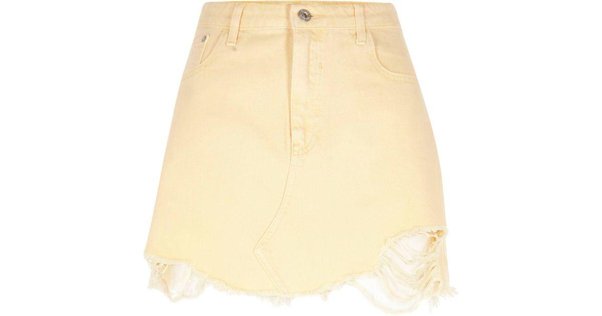 05bc4660a3 River Island Light Yellow Ripped Hem Denim Mini Skirt in Yellow - Lyst