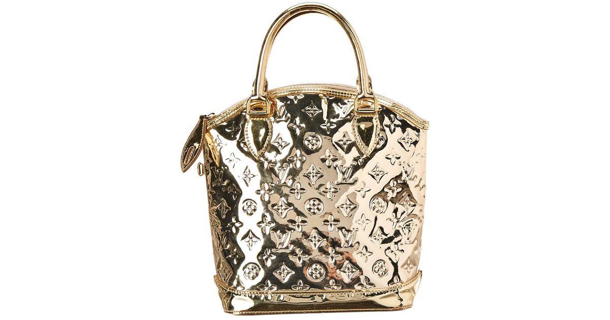 19e0dbff2374 Lyst - Louis Vuitton Limited Edition Gold Monogram Miroir Leather Lockit in  Metallic