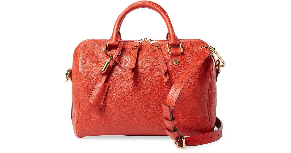 Lyst - Louis Vuitton Red Monogram Empreinte Leather Speedy 25 Bandouliere  in Red d6b72598f6efa