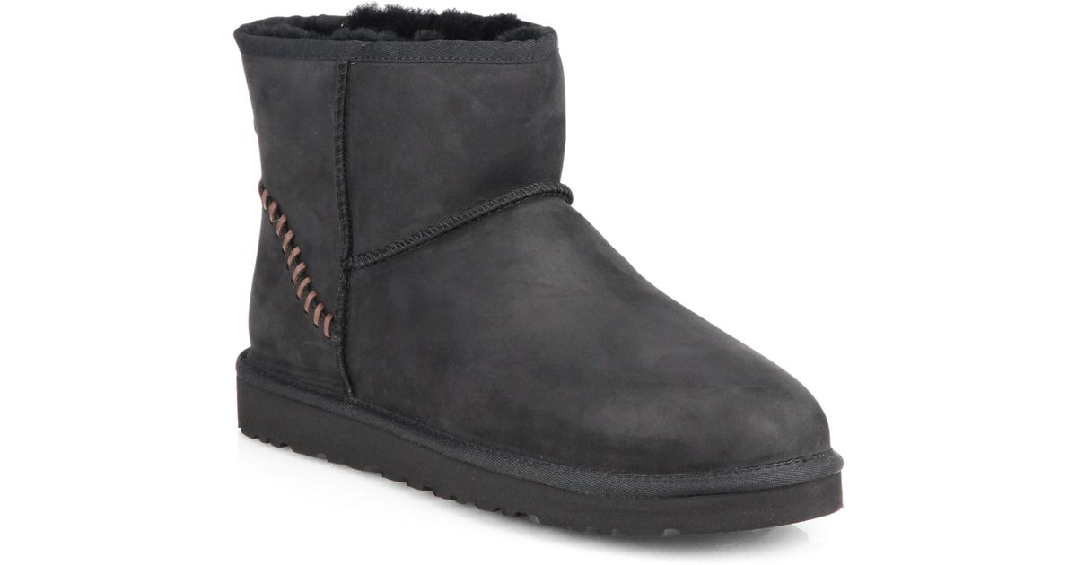 ugg classic mini shearling lined leather boots in black