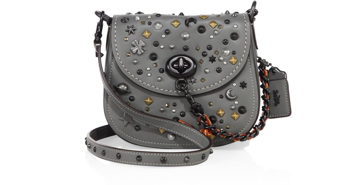 f8925f33aed7 Lyst - COACH Stardust Studded Leather Saddle Bag in Gray