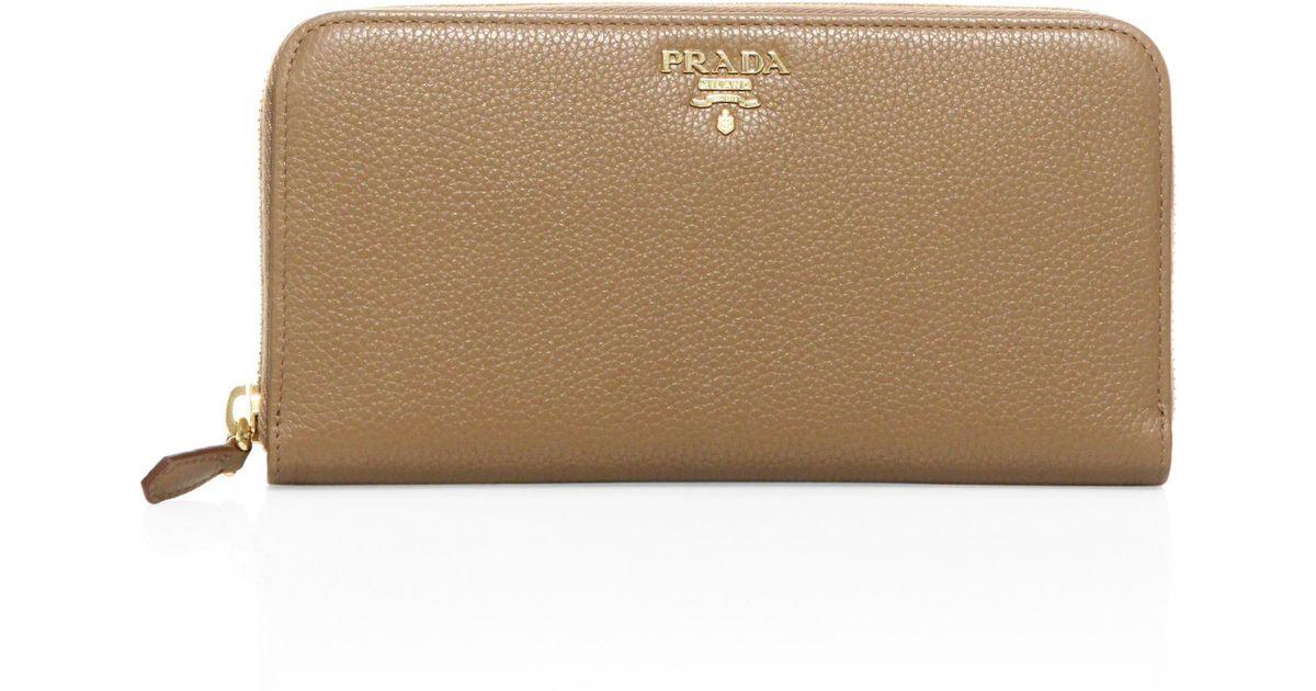 6e190e80f6f44c Prada Women's Leather Zip-around Wallet - Caramel Papaya - Lyst