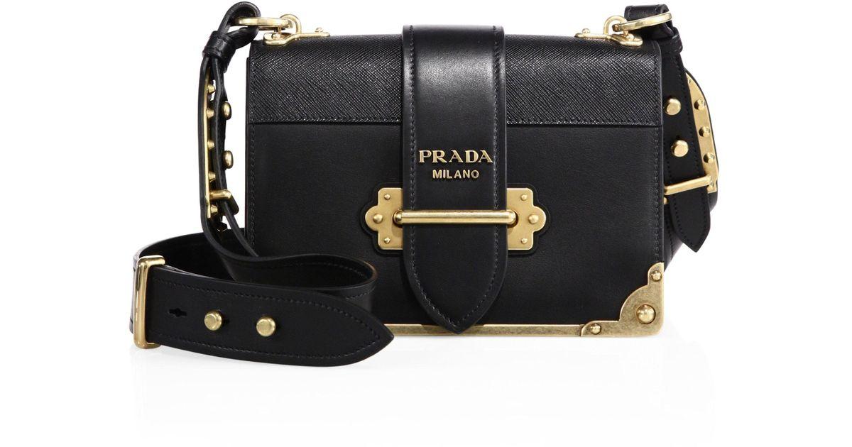 03e4f83b7642 ... week prada pionnière and cahier f88d6 13e7f czech lyst prada cahier  notebook leather shoulder bag in black d02b8 e35f0 ...