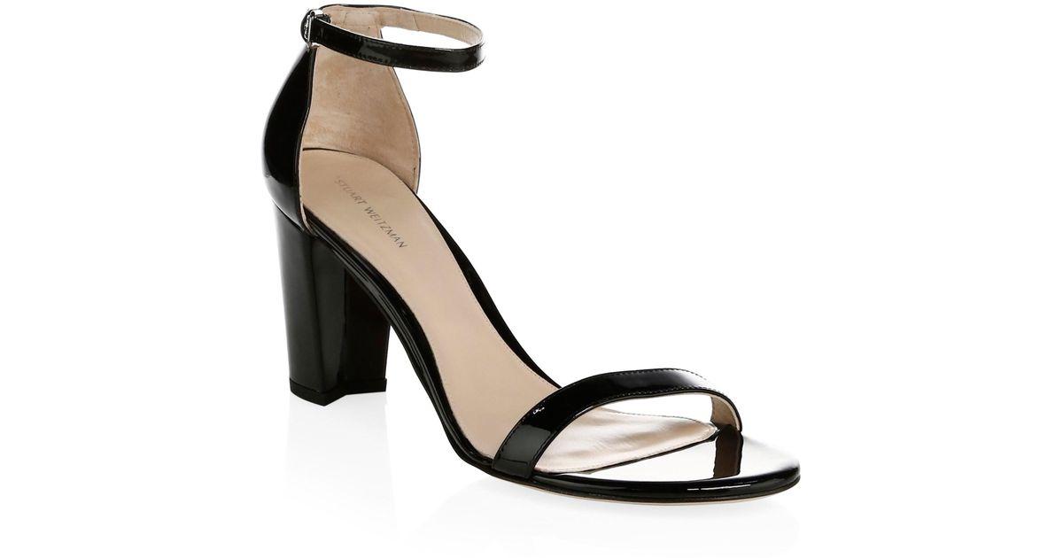 59bcbbc4263 Lyst - Stuart Weitzman Nearlynude Patent Leather Block Heel Sandals in Black