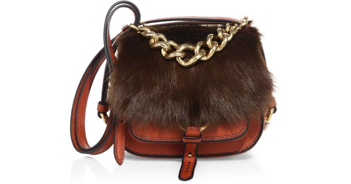 2c2538f44216 Miu Miu Dahlia Shearling   Leather Saddle Bag in Brown - Lyst