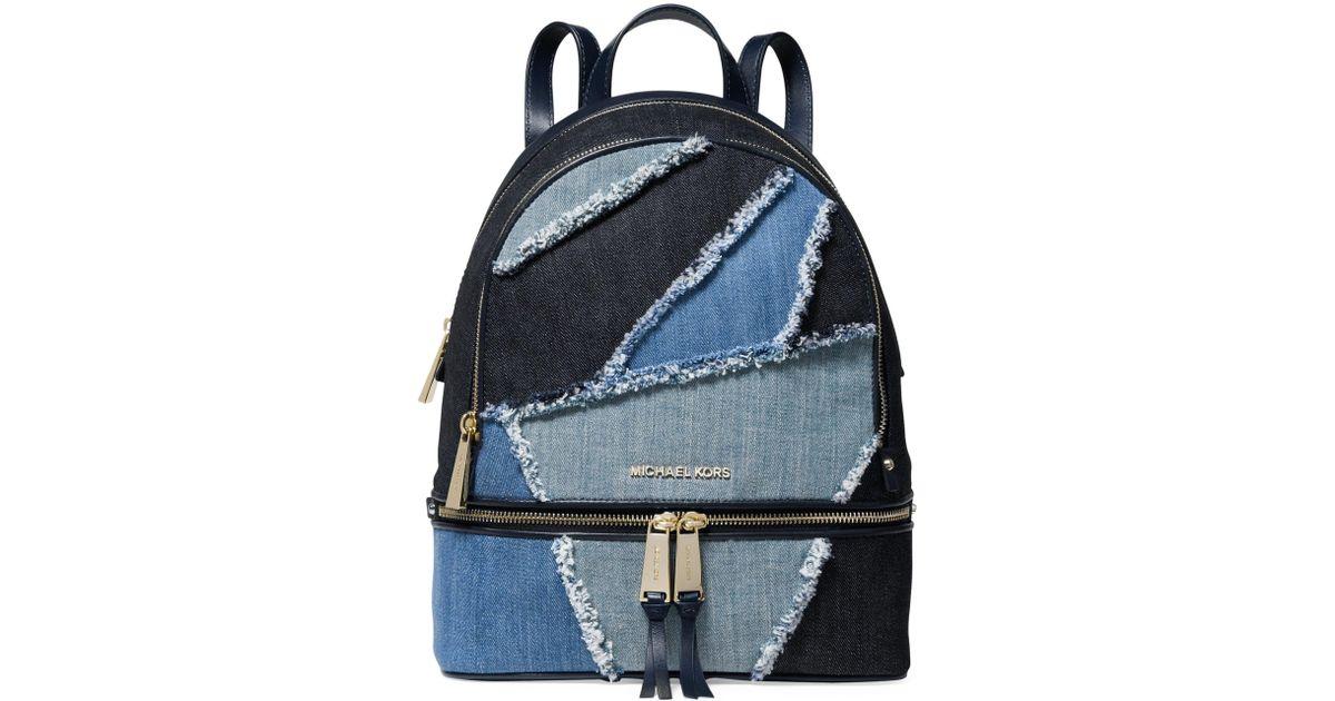 fcbf7bd3a1c044 MICHAEL Michael Kors Rhea Medium Frayed Denim Backpack in Blue - Save 46% -  Lyst