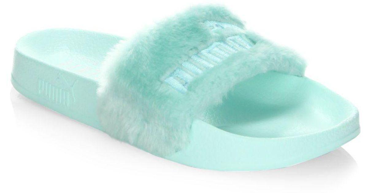 big sale 43574 8f8d7 PUMA - Blue Fenty By Rihanna Faux Fur Logo Slides - Lyst