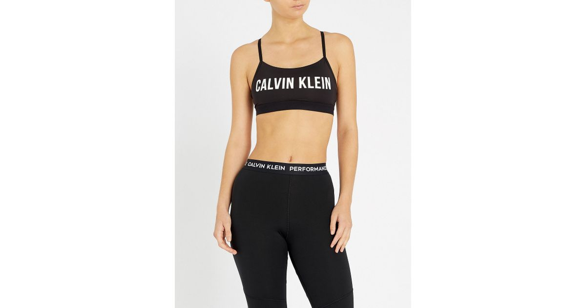 0dc3f42a64d57 Lyst - Calvin Klein Active Logo-print Adjustable Stretch-jersey Sports Bra  in Black