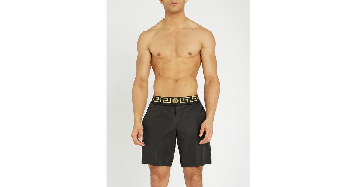 423f918cb7b0 Lyst - Versace Iconic Swim Shorts in Black for Men - Save 78%