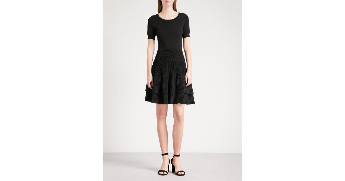 bf633996faf Lyst - Maje Raliano Pleated Ribbed-knit Mini Dress in Black